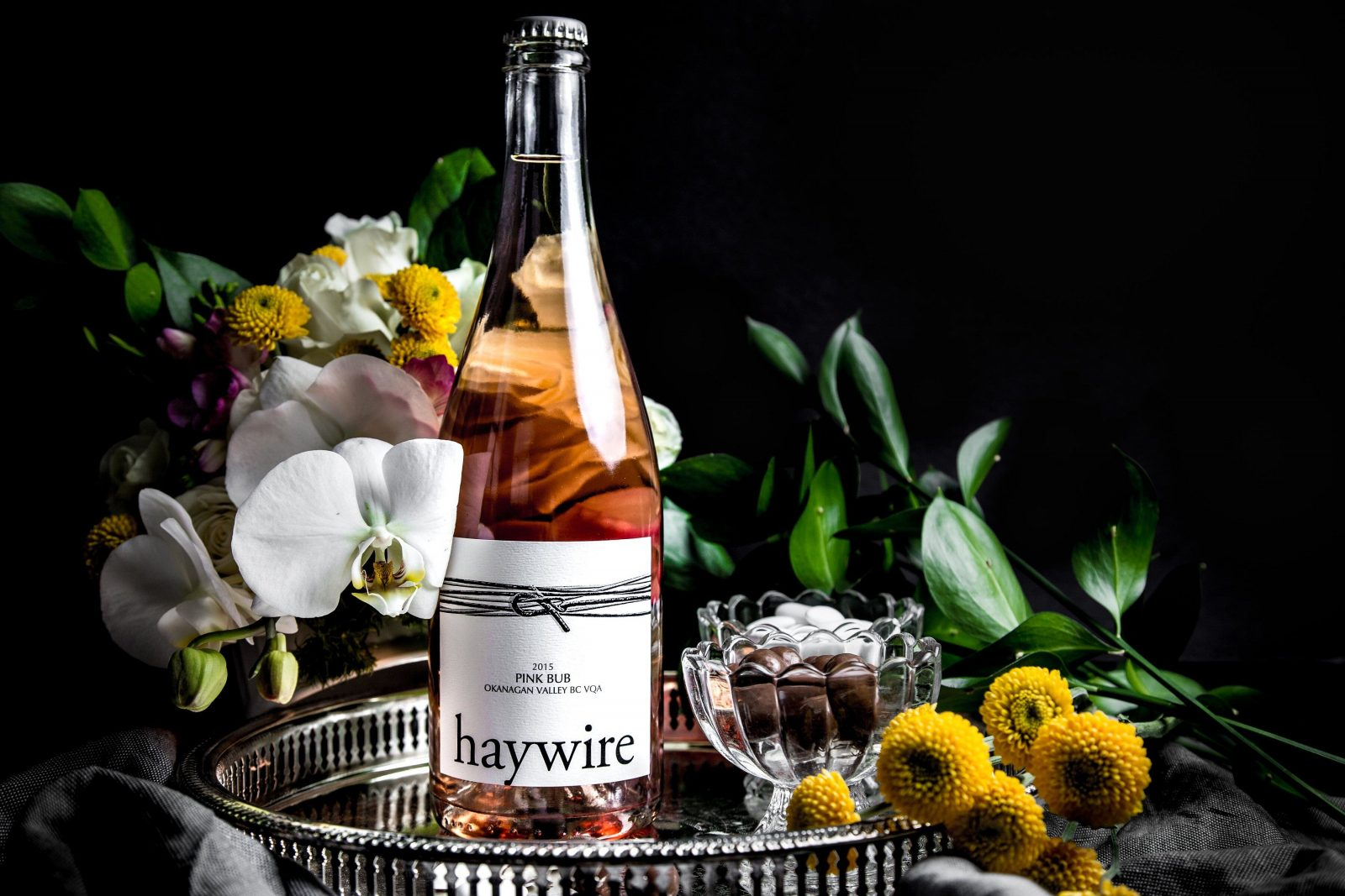 Haywire Pink Bubbly on a platter with flowers